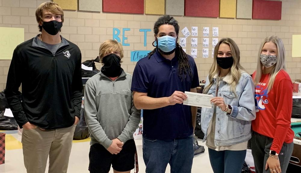 LHS students presenting $1600 check to the Cooke county boys and girls club