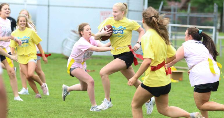 Abby Hellman runs with the ball at color day on May 21.