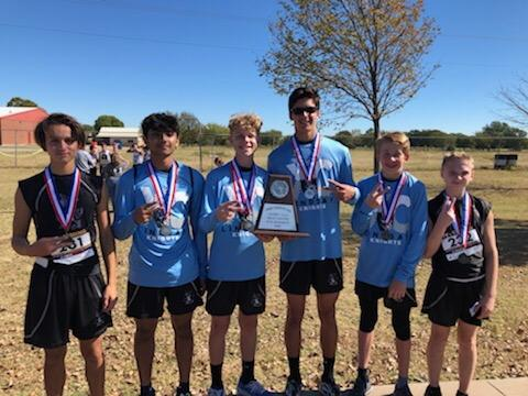 boys cross country team photo, taken after the district meet