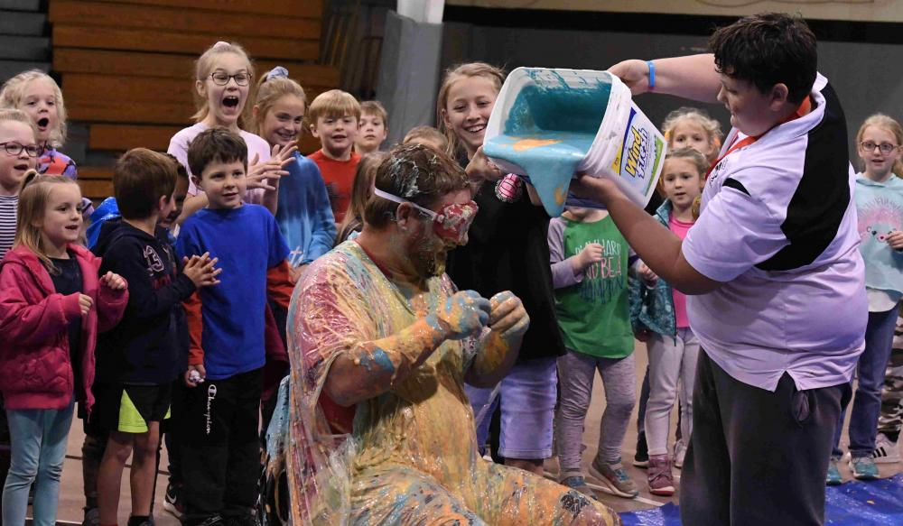 coach Bobby is about to get a bucket of slime poured on him