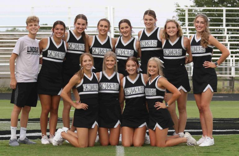 varsity cheer group picture taken at Meet the Knights event