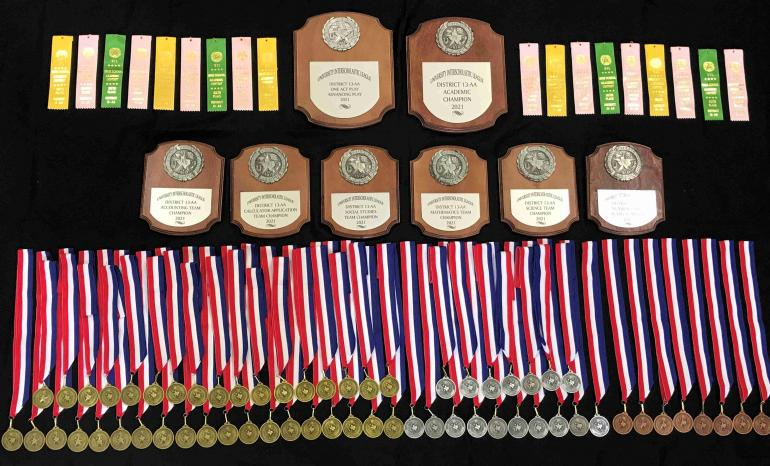 photo of medals and plaques won at district