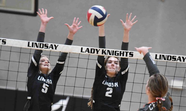 Macey and Kylee go for the block against Celina