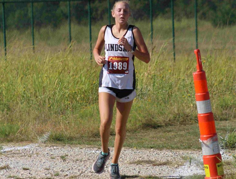 Allison Hedrick runs at Boyd