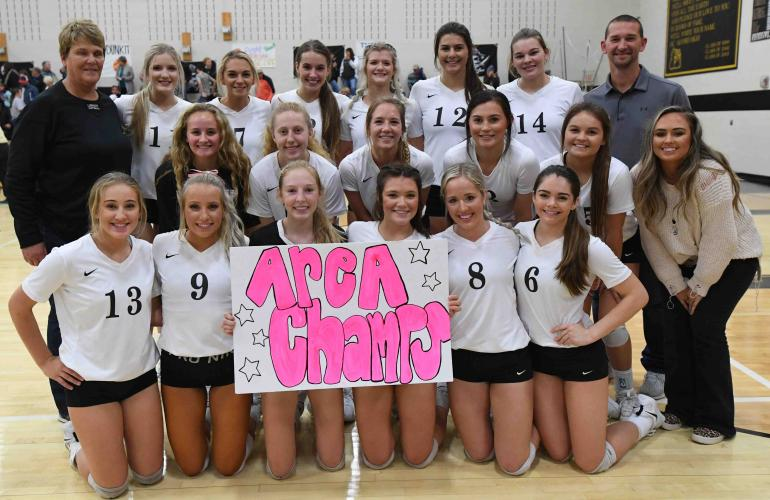 volleyball team holding sign after Petrolia game