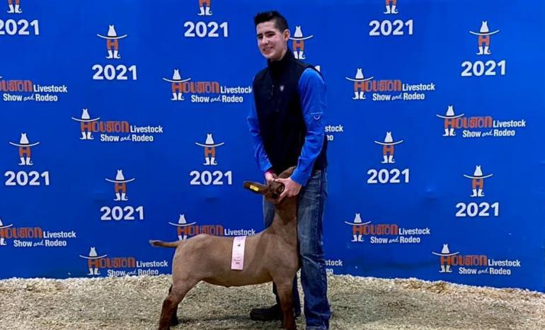 Kade Branson poses with his goat at Houston.