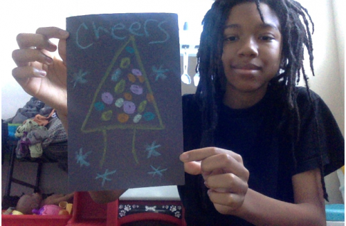 Seventh grader Terrane Lewis III of Baton Rouge shows his colorful tree card that says cheer.