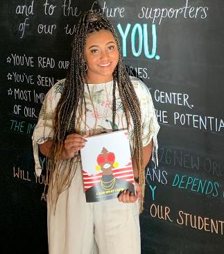 Amari Hurst holding her book