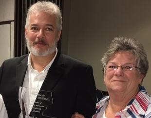 Wade Henderson with his award and Linda Holliday.