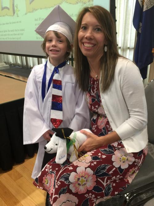 Teacher poses with girl UVA Kindergarten Graduate of 2018