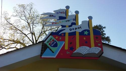 house sign reading shu shu's fun learning depot