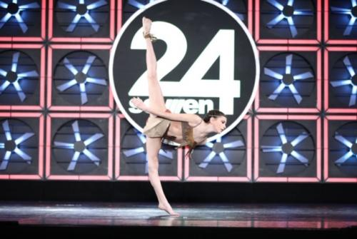 Chloe Barbera doing a standing split at a competition