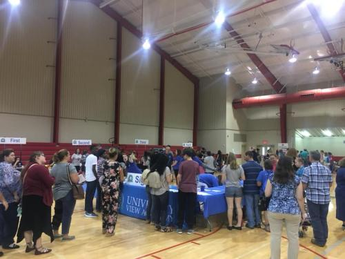 Students and parents in a school gym for the Baton Rouge Open House 2018