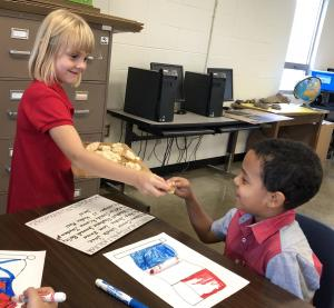 Second graders try a French baguette