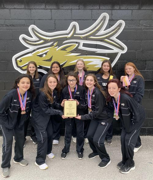 JH Girls District Champions 2021, team photo with plaque