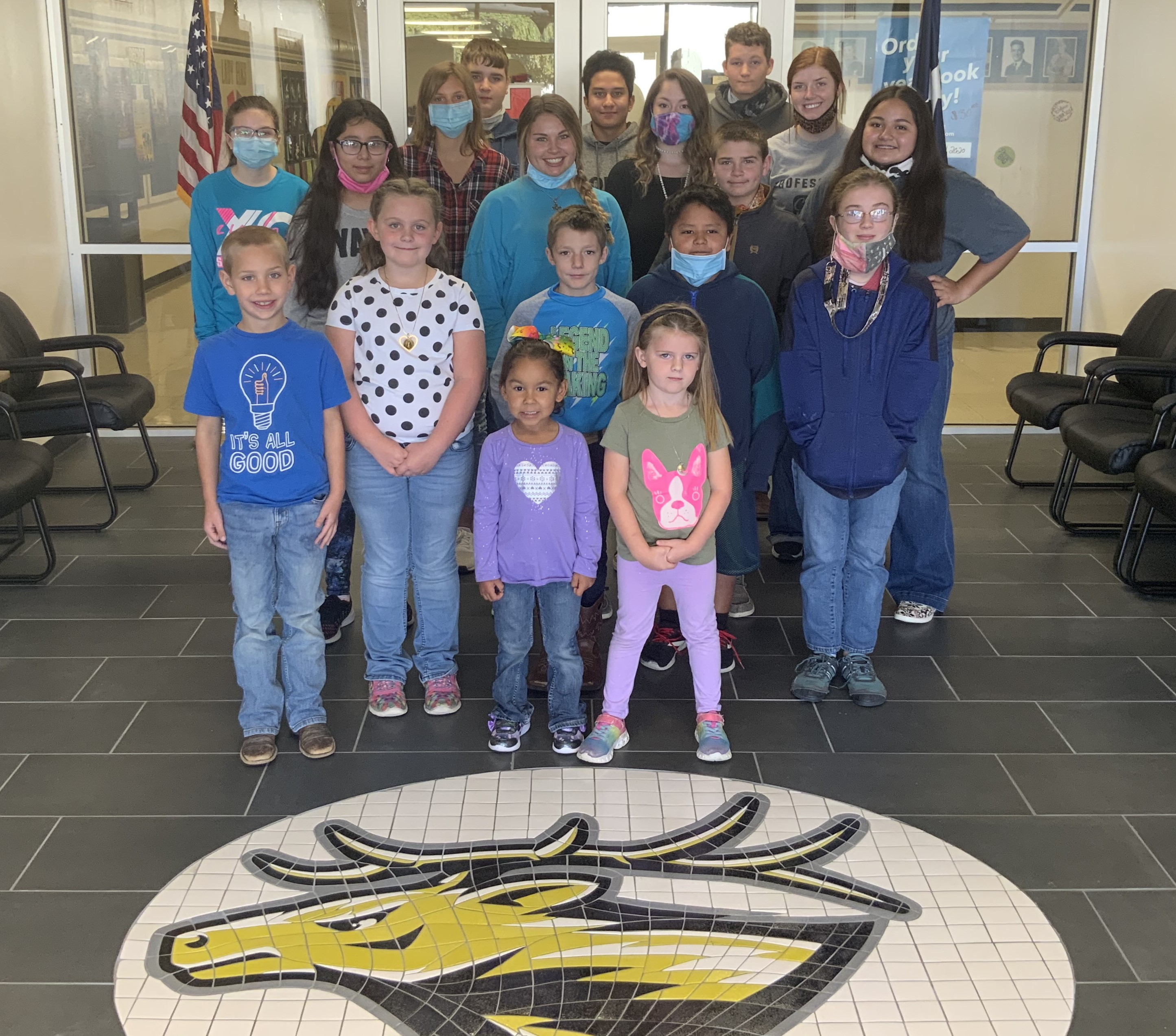The Evant ISD Heritage Foundation funded the renovation of our school lobby. This photo shows student representatives as well as the new furnishings and tile floor with a mosaic of mascot.