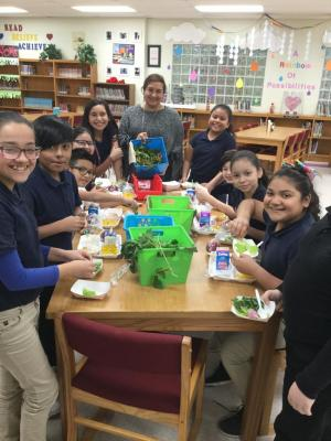 GT Students eating vegetables from the Harvest Garden
