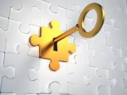 Picture of a Gold Key unlocking a puzzle piece