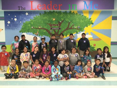 Students who demonstrated they were leaders take a group picture