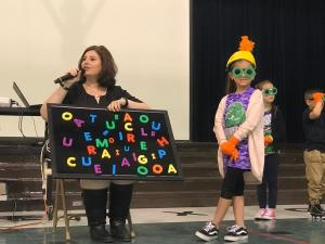 2nd Grader, Donna Rodriguez, steals magnetic vowels dressed as book character, the Thief.