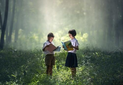 Kids Reading book in Nature