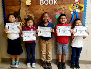 1st Grade: (L to R)  Kayle Cantu, 3rd Place - Daniela Hernandez, 2nd Place - Christian Angelo, 1st Place - Esai Rendon, Alejandro Arriaga
