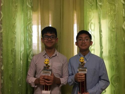 In order from left to right: Nathaniel Rimocal - Spelling Bee Runner Up - 6th Grade, Emmanuel Rimocal - Spelling Bee Champion - 8th Grade