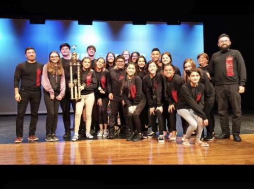 One Act Play group winning the 1st place trophy at the UIL Event