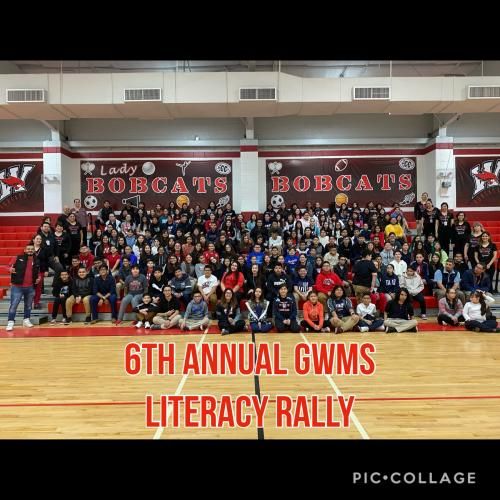 student group picture of Literacy Rally at the gym bleachers
