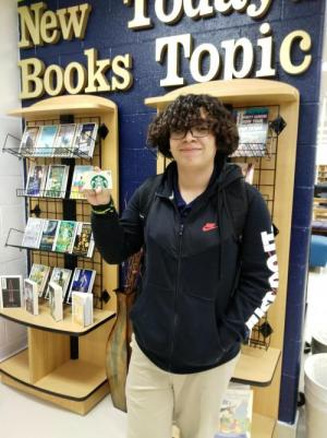 Alan Gonzalez won a Starbucks gift card for being the first student to check out a book this school year!