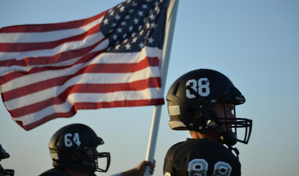 CP Pirate Football and American Flag