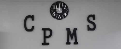 CPISD CPMS Initials with clock over the MS office doors