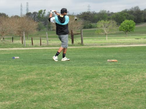 picture of student playing golf