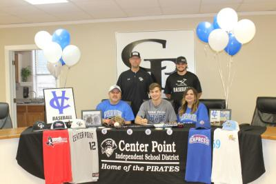 A. Hander and family Signing for College