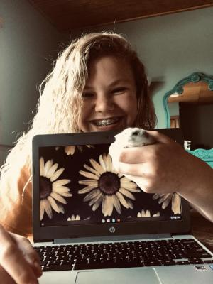G. Geurin with her Hamster working from home!