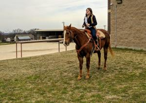 Madison Braden with her horse from the Forestburg Rodeo