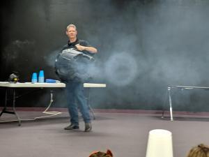 Mr. Hudspeth demonstrating the wind vortex apparatus.