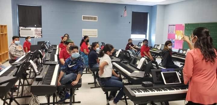 Ms. Salgado's 4th Grade Class enjoying their Music Lesson with Ms; Christina Benitez.