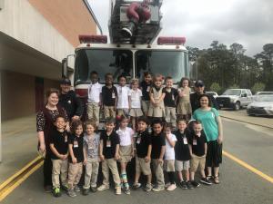 Mrs. Austin's LA 4 Class in front of a fire truck.