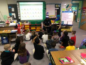 Fireman reads to students