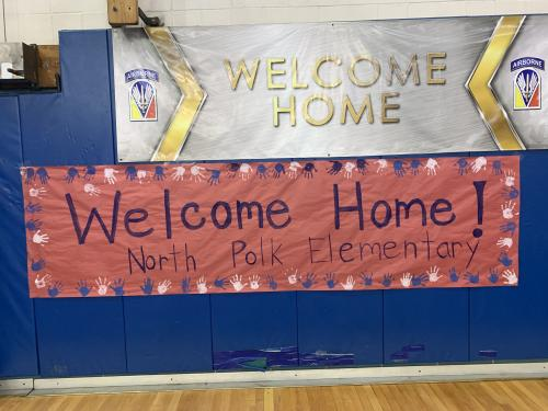 Welcome home signs! Pre K students made one with their handprints.
