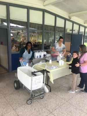 Mrs. Craig and Mrs. Cunningham, our expert snowcone makers!