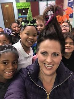 Mrs. Robertson and students on crazy hair day!