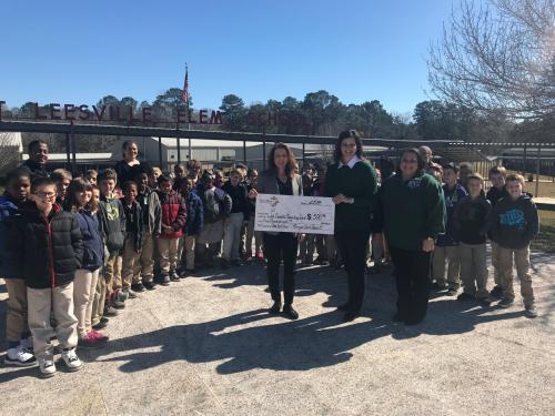 Christmas Cheer check presentation to Mrs. Robertson and W.L.E. students.