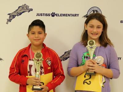 fourth graders Yeshua Gonzalez and Samantha Hendricks from Justiss