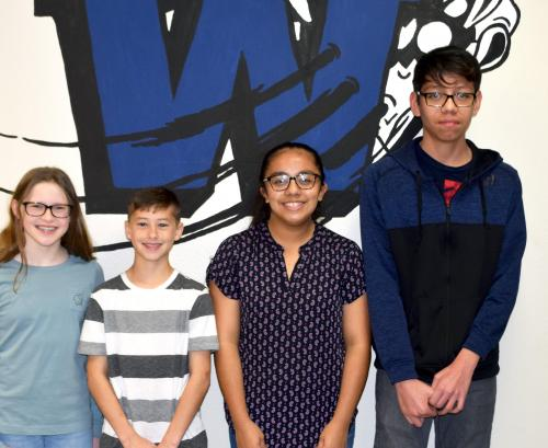 February awards were presented to (from left) seventh graders Sophie Stone and Noah Allen and eighth graders Noamy Medina and Jose Sanchez.