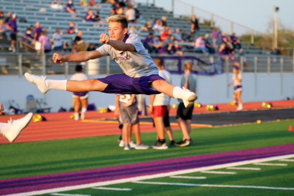 Jacob Henson executes a toe touch at the first home footbal game.
