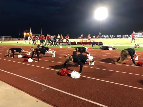 Cheerleaders doing pushups