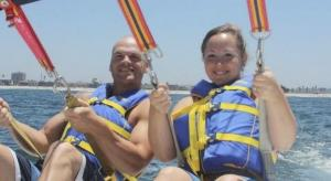 This is my husband Daniel. We were parasailing in San Diego where we used to live.
