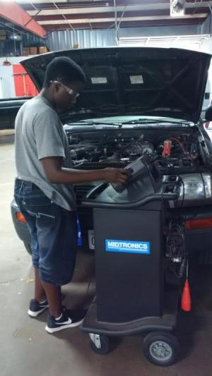 Quinsean checking a vehicle's electrical system